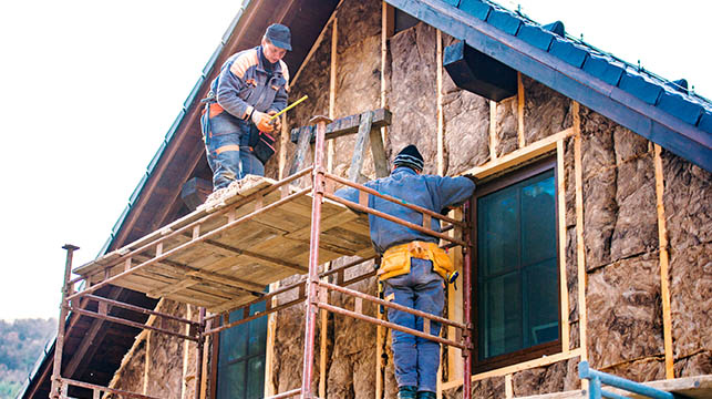 construction workers insulating house