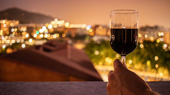 enjoying a glass of red wine in the evening