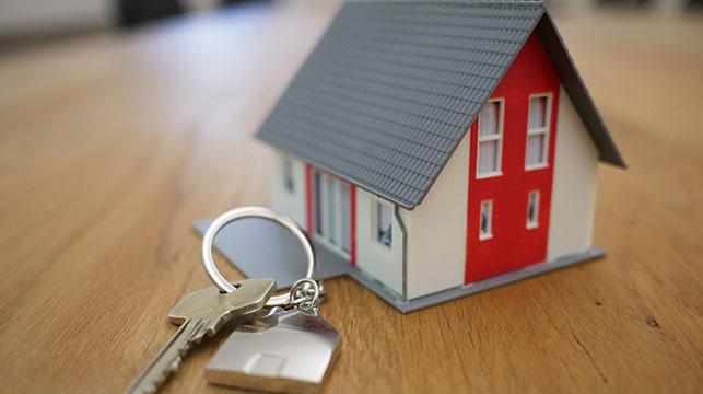 miniature house and key