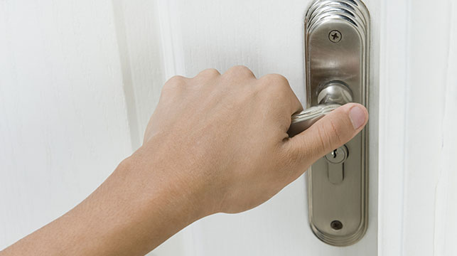 person holding a door handle