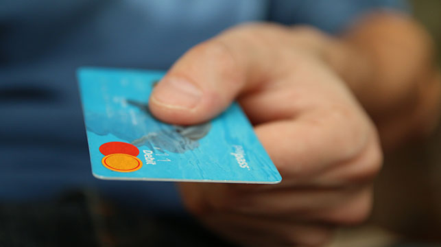 person holding mastercard credit card